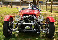Floral ParkFloral Park, New York, U.S. - April 27, 2014 - Front view of a red BRA CX3, a custom Beribo Replica Automobiles kit vehicle with three wheels, and registered by DMV as a 2009 Custom Motorcycle, is exhibited at the 35th Annual Antique Auto Show at Queens Farm.