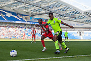 Kazenga Lualua shapes to cross the ball during the Pre-Season Friendly match between Brighton and Hove Albion and Sevilla at the American Express Community Stadium, Brighton and Hove, England on 2 August 2015. Photo by Bennett Dean.