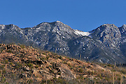 Snow caps a peak in the Santa Rita Mountains near Madera Canyon in the Coronado National Forest, Sonoran Desert, Green Valley, Arizona, USA.