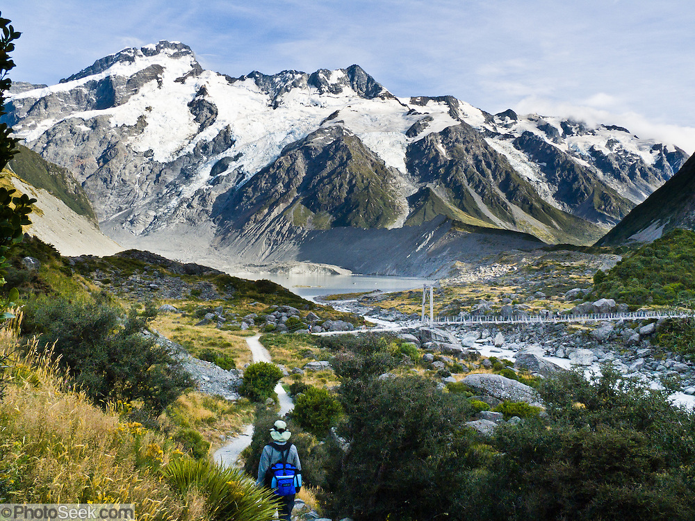 Hike below Mount Sefton near swing bridge on the Hooker Valley Track, Aoraki / Mount Cook National Park, South Island, New Zealand. In 1990, UNESCO honored Te Wahipounamu - South West New Zealand as a World Heritage Area.