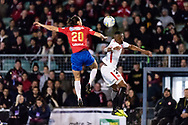 Bonnyrigg White Eagles midfielder Ben Tosi (20) and Western Sydney Wanderers midfielder Roly Bonevacia (28) go up for the ball at the FFA Cup Round 16 soccer match between Bonnyrigg White Eagles FC v Western Sydney Wanderers FC at Marconi Stadium in Sydney.