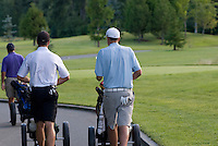 Teenagers walk the golf course during a round of golf on Nicklaus North golf course in Whistler, BC Canada.