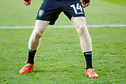 Leeds United midfielder Eunan O'Kane (14) boots with the rainbow laces during the EFL Sky Bet Championship match between Barnsley and Leeds United at Oakwell, Barnsley, England on 25 November 2017. Photo by Simon Davies.