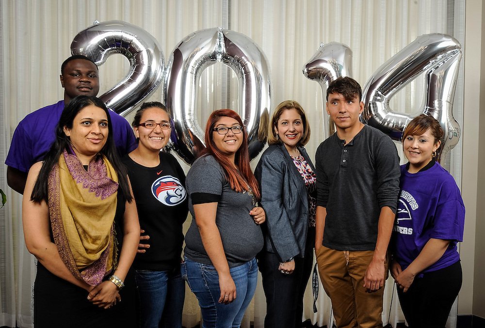 Houston ISD students pose for photographs during the Academic Signing Day activities at the Region 4 Education Center, May 23, 2014.