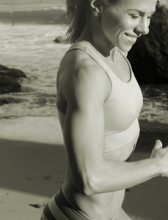 San Diego Fitness Photographer: Young woman exercising at El Matador State Beach in Malibu, CA