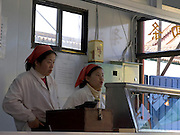 two young girls standing behind the counter in an diner in China