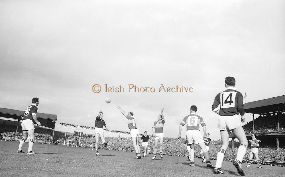 Galway's M.Mc. Donagh punches ball over bar during the All Ireland Senior Gaelic Football final Kerry v. Galway in Croke Park on 27th September 1964. Galway 0-15 Kerry 0-10.