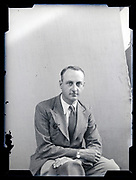 studio portrait of an adult man circa 1930s