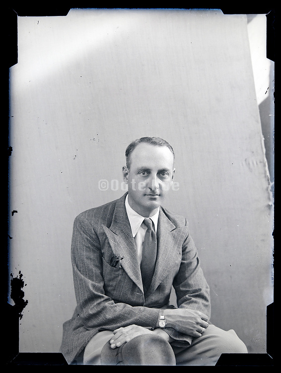 studio portrait of an adult man circa 1930s