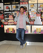 04.SEPTEMBER.2013. LONDON<br /> <br /> PETER ANDRE APPEARS AT THE PERFUME SHOP IN 'INTU' SHOPPING CENTRE IN WATFORD TO RELEASE TWO NEW FRAGRANCES FOR WOMEN, 'FOREVER' AND 'FOREVER YOUNG'<br /> <br /> BYLINE: EDBIMAGEARCHIVE.CO.UK<br /> <br /> *THIS IMAGE IS STRICTLY FOR UK NEWSPAPERS AND MAGAZINES ONLY*<br /> *FOR WORLD WIDE SALES AND WEB USE PLEASE CONTACT EDBIMAGEARCHIVE - 0208 954 5968*