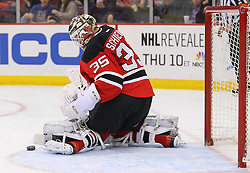 Feb 27, 2014; Newark, NJ, USA; New Jersey Devils goalie Cory Schneider (35) makes a save during the second period of their game against the Columbus Blue Jackets at Prudential Center.