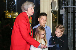 © Licensed to London News Pictures. 19/11/2018. London, UK. British Prime Minister Theresa May switch on the Christmas tree lights outside Number 10.  A traditional Military wives choirs sings carols to mark the Christmas tree lights switch on. Photo credit: Dinendra Haria/LNP