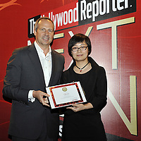 HONG KONG - MARCH 24:  Hollywood Reporter's Senior VP, Publishing Director Eric Mika (L) and Chen Jie during The Hollywood Reporter Next Gen Asia Launch Cocktail Reception event at the W Hotel Kowloon on March 24, 2009 in Hong Kong. The initiative has recognised over 500 individuals under 35 over the last 15 years, and is run in conjunction with the Hong Kong International Film Festival.  Photo by Victor Fraile / studioEAST