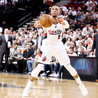 25 April 2016: Portland Trail Blazers guard Damian Lillard (0) passes the ball during the Portland Trail Blazers 98-84 victory over the Los Angeles Clippers, during Game Four of the Western Conference Quarterfinals of the NBA Playoffs at the Moda Center, Portland, Oregon, USA.