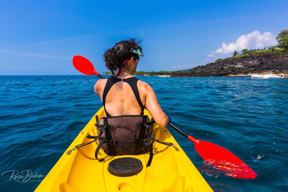 Woman kayaking along the Kona Coast, The Big Island, Hawaii USA