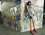 Teenager Against Graffiti Wall