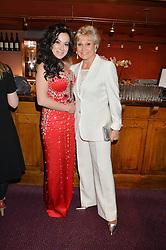 Left to right, NANCY DELL'OLIO and ANGELA RIPPON at the 10th anniversary Gala of the Russian Ballet Icons at the London Coliseum, St.Martin's Lane, London on 8th March 2015.