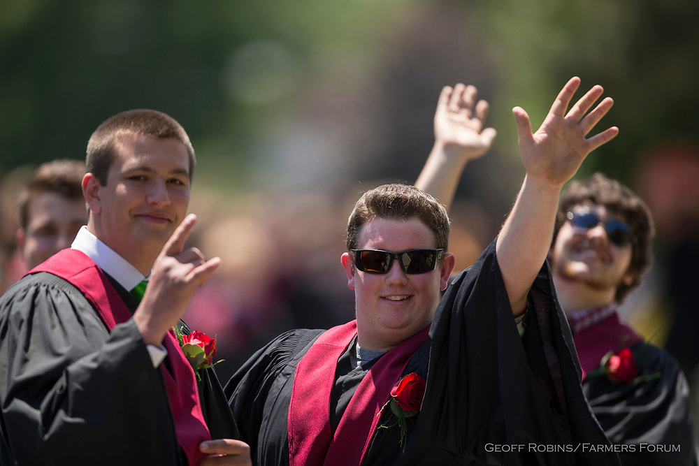 David McTavish (L), Curtis Schill (C) and Anthony Sacks ham it up before their graduation ceremony at the University of Guelph, Ridgetown Campus in Ridgetown, Ontario, Friday, June 2, 2017.<br /> Farmers Forum/ Geoff Robins