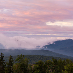 "Clouds hug the ridge of ""The Horn"" (right) on Saddleback Ridge as seen from Quill Hill in Reddington Township, Maine. High Peaks region near Rangeley. Appalachian Trail."