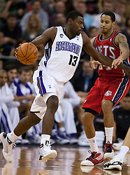 November 27, 2009; Sacramento, CA, USA;  Sacramento Kings guard Tyreke Evans (13) is guarded by New Jersey Nets guard Devin Harris (34) during the first quarter at the ARCO Arena. Sacramento defeated New Jersey 109-96.