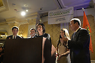 Garden City, New York, USA. 3rd Novebmer 2015. Democrat MADELINE SINGAS claims victory over Republican Kate Murray in the hotly contested race for Nassau County District Attorney. JAY JACOBS (at far right), the Chairman of the Nassau County Democratic Party, and Singas's family joined her on stage. Singas, the Acting District Attorney, took the podium at the Nassau County Democrats Election Night Party at the Garden City Hotel, to thank her supporters, when, with more than 99% of the precincts results in, she was comfortably leading Murray, who's Hempstead Town Supervisor.