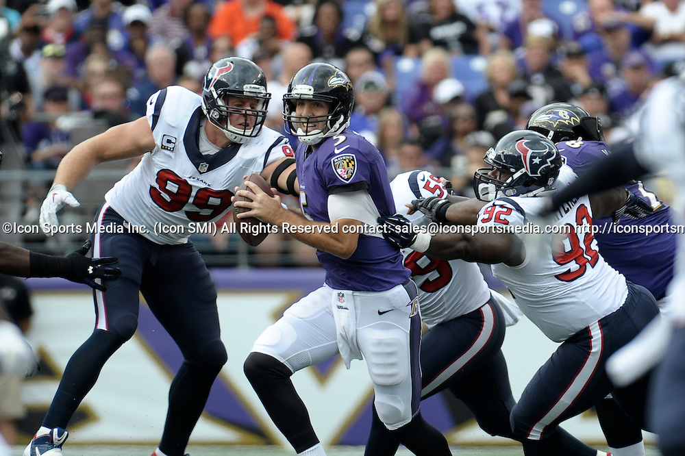 Sept. 22, 2013 - Baltimore, Maryland, U.S - Baltimore Ravens quarterback JOE FLACCO (5) looks to escape the grasp of Houston Texans nose tackle EARL MITCHELL (92) and Houston Texans defensive end J.J. WATT (99) during the second quarter at M&T Stadium in Baltimore, Maryland. Baltimore defeated Houston 30-9