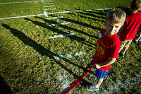 Cole Cooper, a first grader from Prairie View Elementary, looks back at the other competitors on the field before the start of his half-mile race Tuesday during the Post Falls District Cross Country Meet.