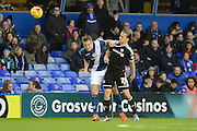 Birmingham City defender Michael Morrison heads away from Brentford striker Lasse Vibe during the Sky Bet Championship match between Birmingham City and Brentford at St Andrews, Birmingham, England on 2 January 2016. Photo by Alan Franklin.