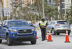 Sunny Isles Beach police directing traffic at Collins Avenue in the Hurricane Irma aftermath on Tuesday, September 12, 2017, in Sunny Isles Beach, FL, USA Photo by David Santiago/El Nuevo Herald/TNS/ABACAPRESS.COM