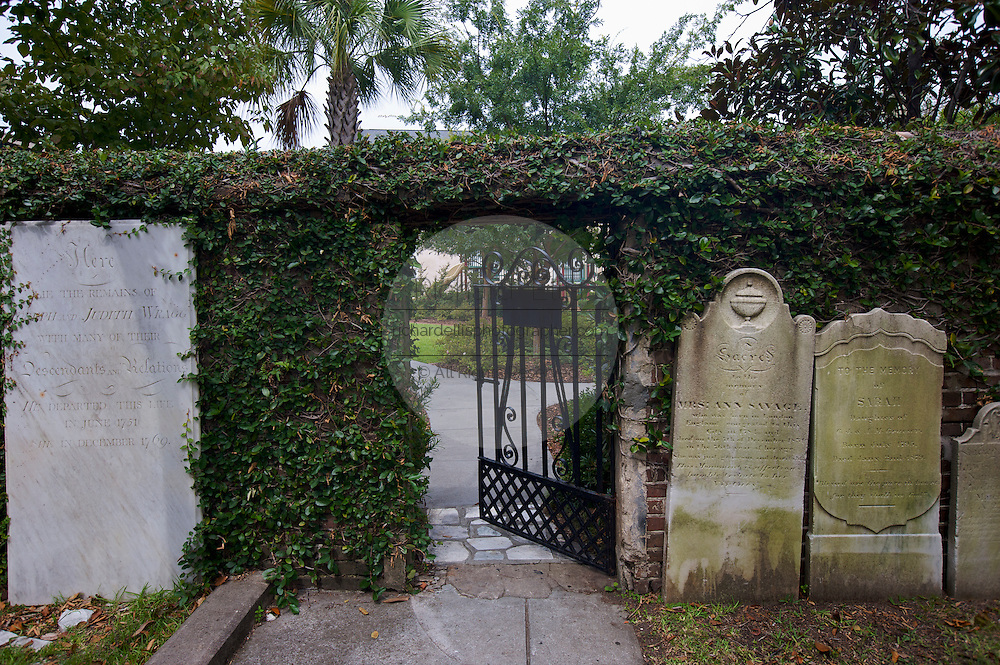 Cemetery gate at historic Saint John's Luthern Church Charleston, SC. Charleston founded in 1670 is considered America's most beautifully preserved architectural and historic city.