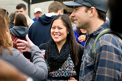 Stephanie Lam (center), of Conshohocken, PA, at the Beer Festival, in Conshohocken, PA, on Saturday. (Bastiaan Slabbers for WHYY)
