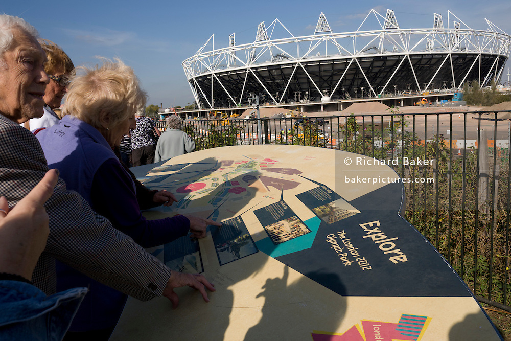 Visitors tour the Grrenway, the closest viewpoint to see the main stadium at the 2012 Olympic Park in Stratford.