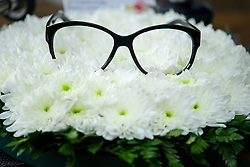 "© Licensed to London News Pictures. 18/04/2016. Shirley, UK.  Ronnie Corbett's glasses resting on flowers next to a note which reads "" .... AND IT""S GOODNIGHT FROM HIM"" at the funeral of comedian, actor, writer Ronnie Corbett at St John the Evangelist Church in Shirley near Croydon. Corbett, who was most famous for his comedy sketch show  The Two Ronnies, performed with the late Ronnie Barker, died at the age of 85. Photo credit: Ben Cawthra/LNP"
