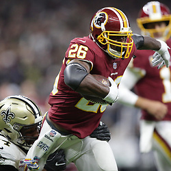 Oct 8, 2018; New Orleans, LA, USA Washington Redskins running back Adrian Peterson (26) is tackled by New Orleans Saints defensive end Cameron Jordan (94) during the first quarter at the Mercedes-Benz Superdome.