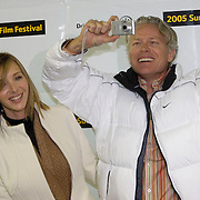 """Lisa Kudrow and her husband Michel Stern turn the tables on the photographers and  take their photo prior to the opening night premier of """"Happy Endings"""" at  the Sundance Film Festival Jan. 20, 2005 in Park City, Utah. August Miller/ Deseret Morning News DIGITAL PHOTOGRAPH"""