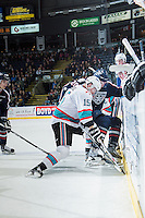 KELOWNA, CANADA - JANUARY 22: Tomas Soustal #15 of Kelowna Rockets digs for the puck at the boards against Maxwell James #20 of Tri City Americans on January 22, 2016 at Prospera Place in Kelowna, British Columbia, Canada.  (Photo by Marissa Baecker/Shoot the Breeze)  *** Local Caption *** Maxwell James; Tomas Soustal;