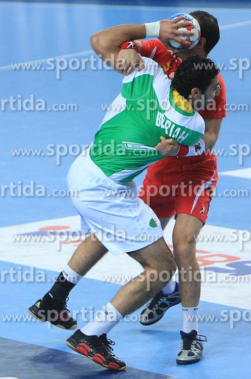 Abderrahim Berriah (17) of Algeria vs Anouar Ayed (21) of Tunisia during 21st Men's World Handball Championship preliminary Group C match between National teams of Tunisia and Algeria, on January 22, 2009, in Arena Varazdin, Varazdin, Croatia.  (Photo by Vid Ponikvar / Sportida)