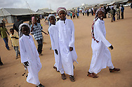 Boys wear bright white garb as Somali refugees gather to pray during celebrations of the Eid ul Fitr to mark the end of Ramadan in the Ifo marketplace at Kenya's Dadaab Refugee Camp, situated northeast of the capital Nairobi near the Somali border, August 30, 2011.