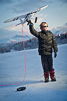 Eleven year old future pilot, Willem Meehan, with his remote controlled model airplane, at Westchester Lagoon, Anchorage.