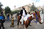 Israel, Palestine, West Bank, Hebron, Jewish Settlers celebrate Purim protected by Israeli security forces. 28 February 2010