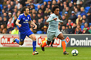 Willian (22) of Chelsea on the attack chased by Harry Arter (7) of Cardiff City during the Premier League match between Cardiff City and Chelsea at the Cardiff City Stadium, Cardiff, Wales on 31 March 2019.