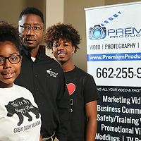 Allen Pegues, center, with son Allen Jr, and daughter Amya.