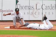 LumberKings third baseman Ramon Morla (22) tags out Kernels first baseman Matt Scioscia (23) during the game between the Clinton LumberKings and the Cedar Rapids Kernels at Veterans Memorial Stadium in Cedar Rapids on Monday, September 3, 2012.