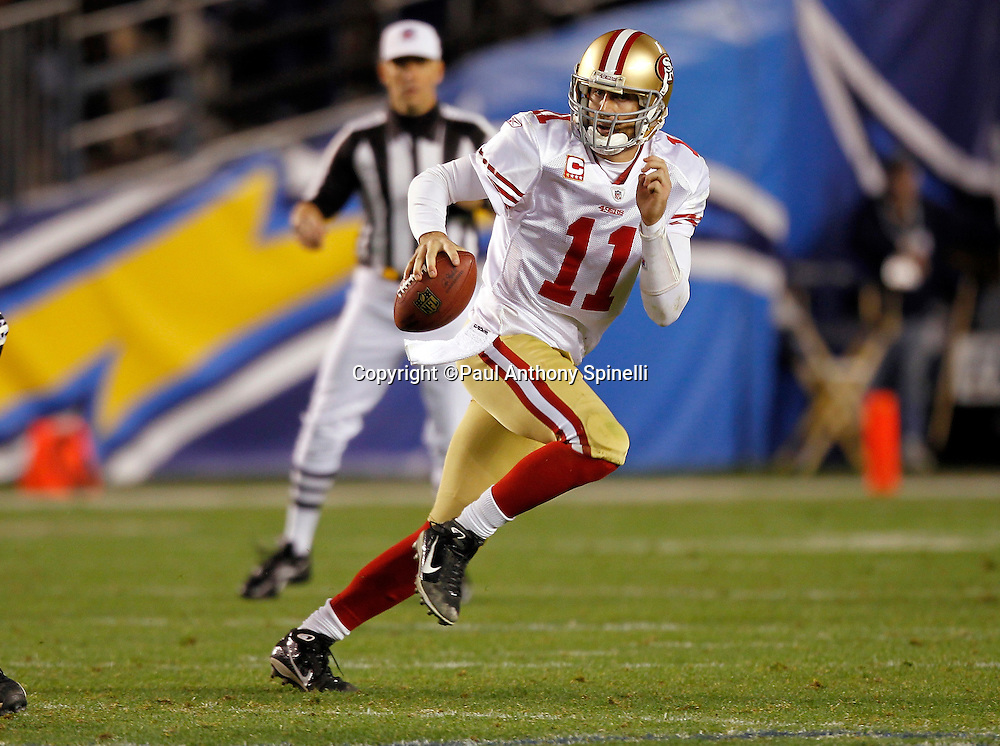 San Francisco 49ers quarterback Alex Smith (11) rolls out while looking to pass during the NFL week 15 football game against the San Diego Chargers on Thursday, December 16, 2010 in San Diego, California. The Chargers won the game 34-7. (©Paul Anthony Spinelli)