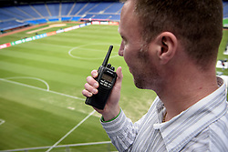 Installation and testing of Kenwood radio system in a stadium.
