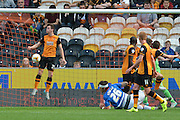 Andrew Robertson  tries to stop Charlie Austins ball going into the next to score 1-0 to QPR during the Sky Bet Championship match between Hull City and Queens Park Rangers at the KC Stadium, Kingston upon Hull, England on 19 September 2015. Photo by Ian Lyall.