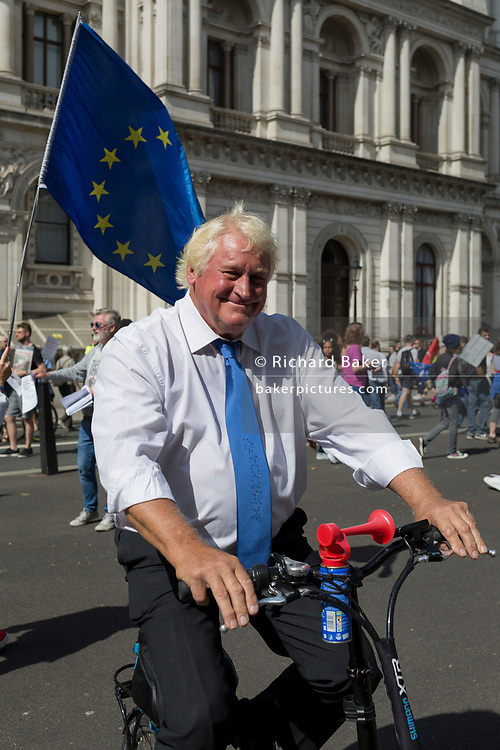 A Boris Johnson lookalike cycles among Pro-EU Remain protesters marching to 'Stop the Coup' in Whitehall, near Downing Street, at the end of a week that saw Prime Minister Boris Johnson ask Queen Elizabeth for permission to suspend (prorogue) the British Parliament during the final stages of his Brexit negotiations with the European Union, in Brussels, on 31st August 2019, in Westminster, London, England.