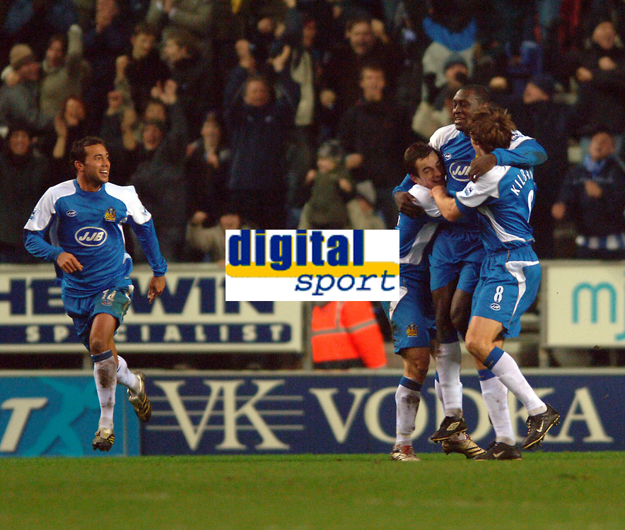 Photo: Paul Greenwood.<br />Wigan Athletic v Chelsea. The Barclays Premiership. 23/12/2006. Wigan's Emile Heskey, right celebrates scoring the equaliser.