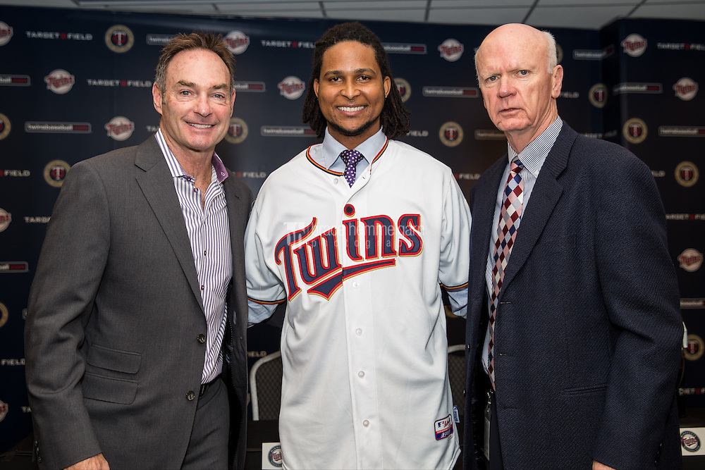 MINNEAPOLIS, MN- DECEMBER 13: Minnesota Twins general manager Terry Ryan and manager Paul Molitor #4 present Ervin Santana #54 to the media on December 13, 2014 at Target Field in Minneapolis, Minnesota. (Photo by Brace Hemmelgarn) *** Local Caption *** Ervin Santana;Paul Molitor;Terry Ryan