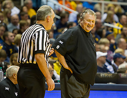 Nov 13, 2015; Morgantown, WV, USA; West Virginia Mountaineers head coach Bob Huggins talks with an official during the second half against the Northern Kentucky Norse at WVU Coliseum. Mandatory Credit: Ben Queen-USA TODAY Sports
